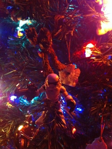 Chewie is about to bring this stormtrooper a present upside his helmet